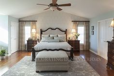 I created a serene, blue and taupe palette for a bedroom with a Country French flair.  There is great contrast between the dark furniture and light color scheme.