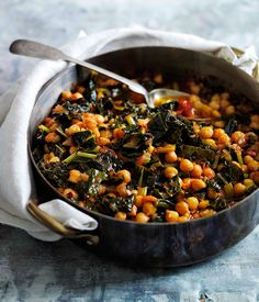Slow-braised chickpeas with cavolo nero  I would substitute vegetable stock for chicken.