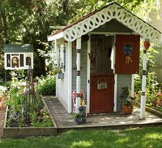 """To eliminate the need for a separate floor surface, this quirky playhouse was sited on a wooden """"bridge"""" between two raised beds./"""