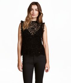d06eb3e4cc54 Black. Blouse in lace with a velvet finish. Small stand-up collar