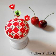 Cherry Pin Keep in egg cups now @ www.CherryChick.biz I have one by my sink where I keep my rings when washing dishes. #Cherries #Pincushion #decorativesewingpins #DecorativePins #pinkeep