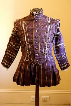 A mushroom coloured silk men's Elizabethan doublet and paned slops, by Andrew Reid (SCA - Master Bartolomeo Agazzari). This was my interpretation of a suit worn by Robert Dudley, and it was the suit I wore to receive my Order of the Laurel in the SCA.