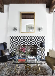 Fantastic fireplace surround with cement tiles, also known as encaustic tiles, for bohemian, Moroccan inspired home decor.