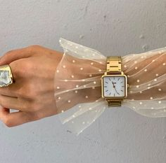 Love this idea: Wear a watch over top of a sheer blouse. #goldwatch