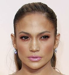 Jennifer Lopez, seemingly ageless, wore a flirty pink lip to The Oscars 2015 that seemed to pick up where her décolletage left off. Click to see more of the best beauty looks from the 87th Academy Awards. (Photo: Noel West for The New York Times)
