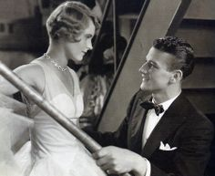 With Lois Moran in Words and Music, 1929 , directed by James Tingling,  a musical comedy film. For the first time Wayne is given on-screen credit as Duke Morrison. Wayne's singing is dubbed. FOX source : Duke - A Life in Pictures, by Rob L. Wagner