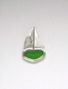 The green sea glass is genuine. It was found and supplied by....  https://www.etsy.com/shop/mamzelleseaglass and is no back bezel set. The pendant
