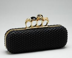 Alexander Mcqueen brass knuckle clutch~Snooki is now making a copy of this in her line