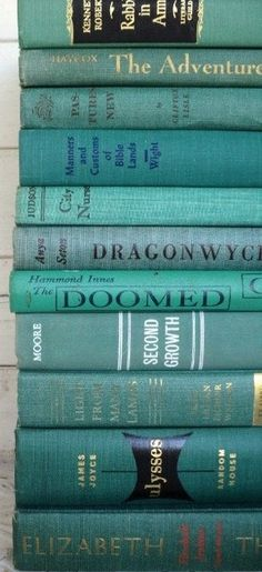 I want a book stack like this! - Oooh! 2 of my favorite things: books and the color turquoise