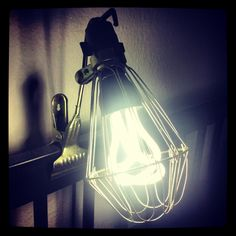 Industrial clamp lamp with Plumen light bulb