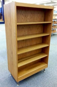 A double sided solid wood bookcase with adjustable shelves. It measures approximately 37'W x 20'D x 66.5'H. The quantity of adjustable shelves included are shown in the photos. It is used but in good solid condition.