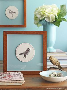 Take old coasters and frame them for cheap wall art - love the light blue