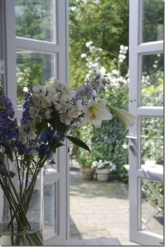 The walled cottage garden would be viewed through the french doors leading from the sitting room