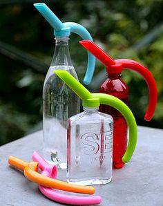 ingenious - watering can spout to add to any bottle!  Love all the colors!  I also love how they take up less space then other watering cans.
