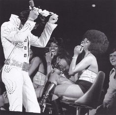 Elvis playing around on stage with lady's undergarment - (Madison Square Garden 1972. According to Elvis Australia website it's from June 16, 1972 - Chicago Stadium)