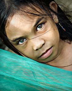 "Girl in the Philippines. BBC Boracay says: "" We like this photo a lot. What is in her mind - the eyes don't tell...Simply beautiful."""