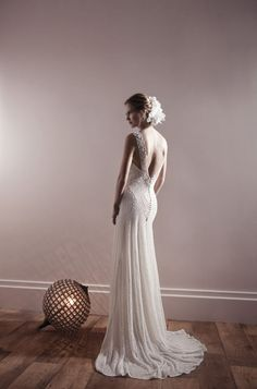 Get inspired: A stunning statement backless wedding gown. So dramatic!