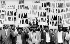 """Memphis sanitation workers strike in 1968 with """"I Am A Man"""" posters, which emerged as a unifying civil rights theme."""