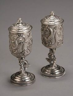 Pair of Chinese Export Repoussé Silver 'Dragon' Covered Cups, Circa 1900
