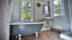 Fab grey and white roll top bath at Kittiwake #grey #white #bath #rolltop #luxury