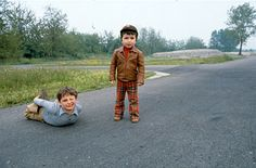 Silly boys playing in the street. Social Meaning, Boys Playing, New Pins, Little Man, Curiosity, Thought Provoking, Real Life, Portrait Photography, Two By Two
