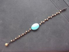 A personal favorite from my Etsy shop https://www.etsy.com/listing/92277353/single-gold-brass-beads-turquoise