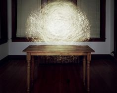 Table with Mylar and Flashlight, 2009, by Caleb Charland