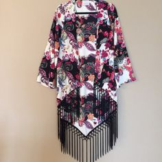 🔺SALE🔺NWOT Beautiful Print Tasseled Kimono Beautiful array of colors and design. Open style with tassels around bottom. Hand wash / hang dry. Never worn. In excellent condition! Jackets & Coats