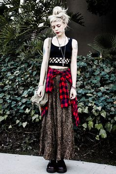 Sliver of skin / maxi skirt / flannel tied around the waste - so cute!  This could be done boho or preppy too (doesn't have to be grunge)