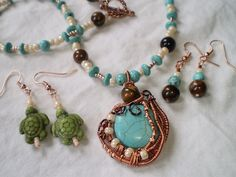 Wire-wrapped and beaded jewelry by Sarah Blankenship  sarah@crystalpaintbrush.com www.crystalpaintbrush.com