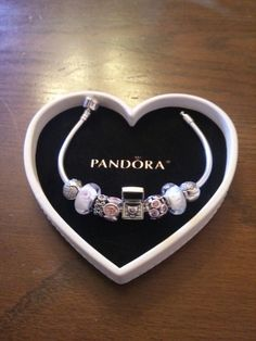 My bracelet with the new exclusive 2014 Pandora Club charm. I love the charm!