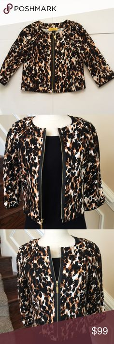 "St. John Exposed Zipper Animal Print Jacket Stunning!! St. John Animal Print Jacket with Exposed Black Zipper. Unlined Jacket with 3/4 Length Sleeve. This Beautiful Animal Print is 97% Cotton and 3% Spandex, a fabulous heavy weight fabric perfect for every occasion!                               17 3/4"" across the chest. 18"" from shoulder to bottom. Excellent condition, never worn! St.John Jackets & Coats"