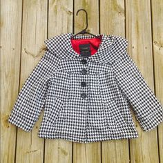 Black and white Anthroplogie swing jacket In excellent condition. Brand is Sanctuary Clothing for Anthropologie. No rips or stains. One button missing at the wrist. Front pockets. Back is cinched with a button. Fully lined. Very flattering! Thanks for looking. Anthropologie Jackets & Coats