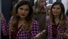 """Mindy's purple houndstooth coat and skirt, seen on the subway in """"Fertility Bites"""", is another custom Salvador Perez original! With sparkly buttons, a coordinating colorblock blouse and oversized statement earrings, this is, despite tough competition, my pick for most outstanding outfit of the episode!"""