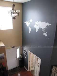 Two Story Foyer Wall World Decal from:  https://www.etsy.com/shop/DecaIisland Wall- Crucible from Valspar Done by me, with a scaffold.  :)