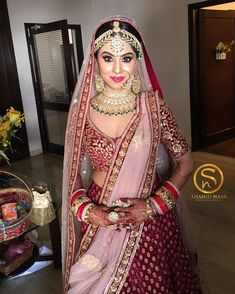Stunning plum bridal lehenga for the bride to slay in at her big day! Indian Bridal Outfits, Indian Bridal Lehenga, Indian Bridal Fashion, Indian Bridal Makeup, Indian Bridal Wear, Bridal Dresses, Latest Bridal Lehenga, Indian Bridal Jewelry, Pink Bridal Lehenga