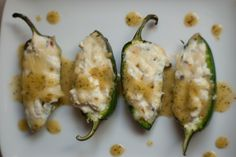 grilled jalapeno poppers with cilantro lime sauce. 4 slices  bacon, cooked and roughly chopped,   8 oz cream cheese  1/2 cup shredded monterrey jack cheese   chives, finely chopped  1 lime, juiced/zested  3 cloves minced garlic,  Salt/pepper  24 jalapeño halves. Sauce: 3 limes, juiced and zested, 2 garlic cloves, 1 teaspoon agave nectar, 1 bunch cilantro,   1/2 cup of plain 0% greek yogurt.