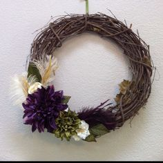 I like the flowers used and the placement but would change the colors. Too drab. They blend into the wreath.