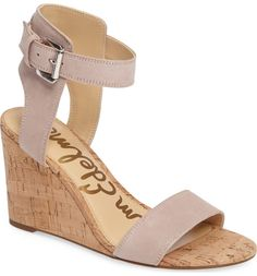An architectural ankle strap and a simple toe strap add flirty fun to this warm-weather wedge sandal.
