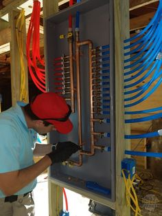 Install a PEX Manifold: After all of your connections are made, install your bell hangers and secure your manifold in place. Water Plumbing, Pex Plumbing, Bathroom Plumbing, Water Pipes, Bathroom Fixtures, Bathrooms, Plumbing Drains, Plumbing Pipe Shelves, Plumbing Pipe Furniture