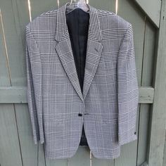 ❄️Gianni Versace black and white blazer jacket! Gianni Versace black and white checkered suit coat! From early 90s. Great condition however two flaws to note: a small hole in back neck area and over the right shoulder. Exact Size unknown so please check via measurements. Euro 46 so roughly a 10/12 In USA. Length 30 inches. Shoulder to shoulder 19 inches. Arm length 24 inches. Chest flat 20 inches. Bundle and save! Versace Jackets & Coats Blazers