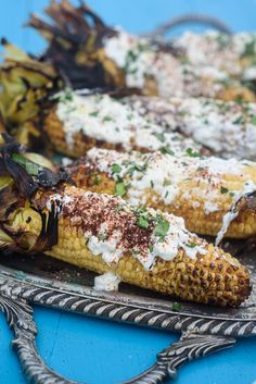 This healthy grilled mexican corn is always the star of the party. We substitute greek yogurt for mayonnaise for a healthy swap, add crumbly mexican cheese, spices, cilantro and plenty of lime juice.