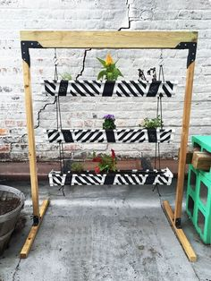 Vertical Gutter Herb Garden / Planter Love this idea, I'm going to make a bunch of these  and use pallet wood for the frames.