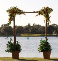 Ceremony arbor with terra cotta pots and plants