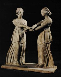 Two dancers, terracotta group, early 3rd BCE, from Tanagra, Boeotia, Greece Louvre Museum