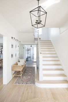 Entry with high ceilings light oak floors pure white walls Circa Lighting Darlan. Entry with high ceilings light oak floors pure white walls Circa Lighting Darlana Lantern Rattan be Light Oak Floors, White Oak Floors, Light Walls, Off White Walls, White Wall Lights, Foyer Decorating, High Ceiling Decorating, Decorating With White Walls, Home Remodeling