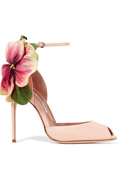 Brian Atwood's celebrity fans include everyone from Lady Gaga to Victoria Beckham. Designed with a bold tropical flower appliqué, these peep-toe sandals have been expertly crafted in Italy from blush ayers and finished with an adjustable ankle strap to help temper the pin-thin stiletto heel. Wear yours with a similarly hued pastel dress.
