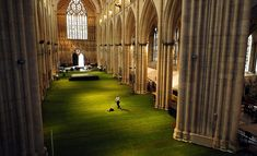 Greenery installation branch wow! grass! of UK turf company lindum has covered the entirety of the nave belonging to york minster cathedral  with a layer of real grass. A team of ten workers extended a layer of plastic upon the ground of the cathedral, then puting in place the soil-less plant artwork, transforming the gothic church's nave into a green expanse of interior space.