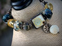 Another JLynnJewels BEAD ART tile (internal drill hole with added corner hole for dangle) featured in a beautifl bracelet design from Amanda of SEaShoreGlass -  Artisan Bracelet, Vintaj Natural Brass, Art Beads, Handmade OOAK Designer Bracelet. $59.00, via Etsy.