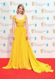 Lea Seydoux in a yellow Prada ochre silk georgette gown at the 2015 BAFTAs